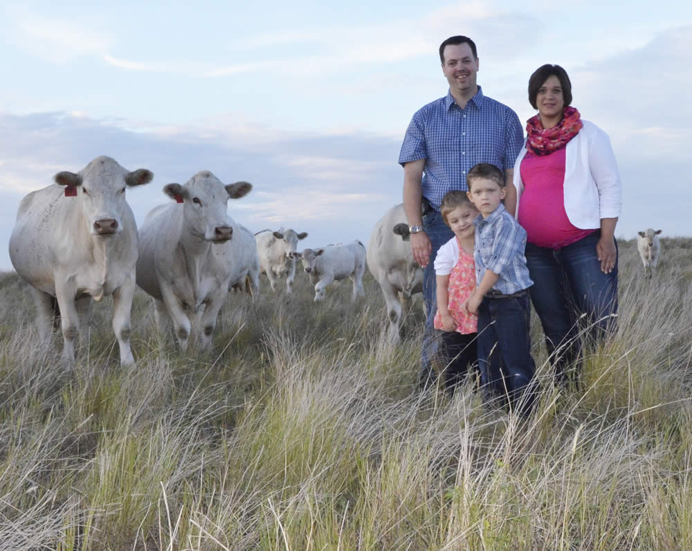 The Howe Family with their Charolais