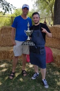 Clinton Monchuk presents trophy to Chef Steve Squier