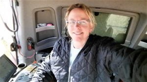 Nancy Johns in the cab of her combine.