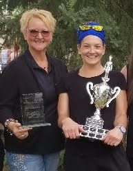 Adele Buettner with Farm & Food Care presents the Top Chef Saskatchewan trophy to Chef Dana Chadorf